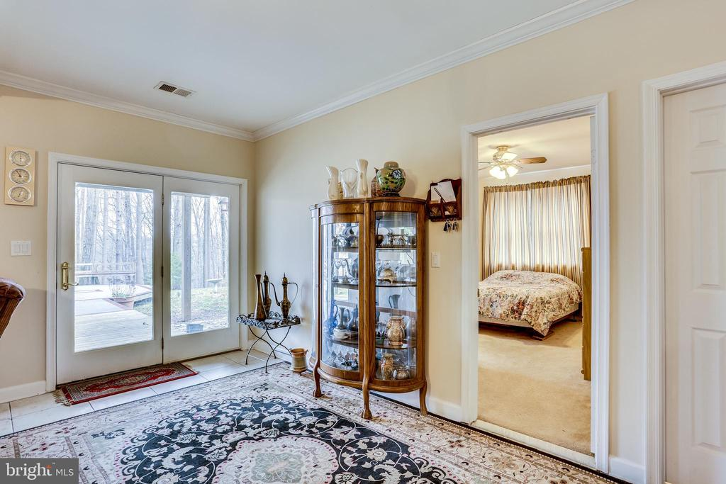 LOWER LEVEL DOUBLE GLASS DOORS TO PATIO - 7365 BEECHWOOD DR, SPRINGFIELD