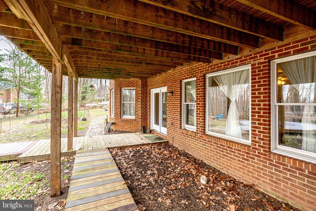 WALKWAY LEADING TO PATIOS OF TWO IN-LAW SUITES - 7365 BEECHWOOD DR, SPRINGFIELD