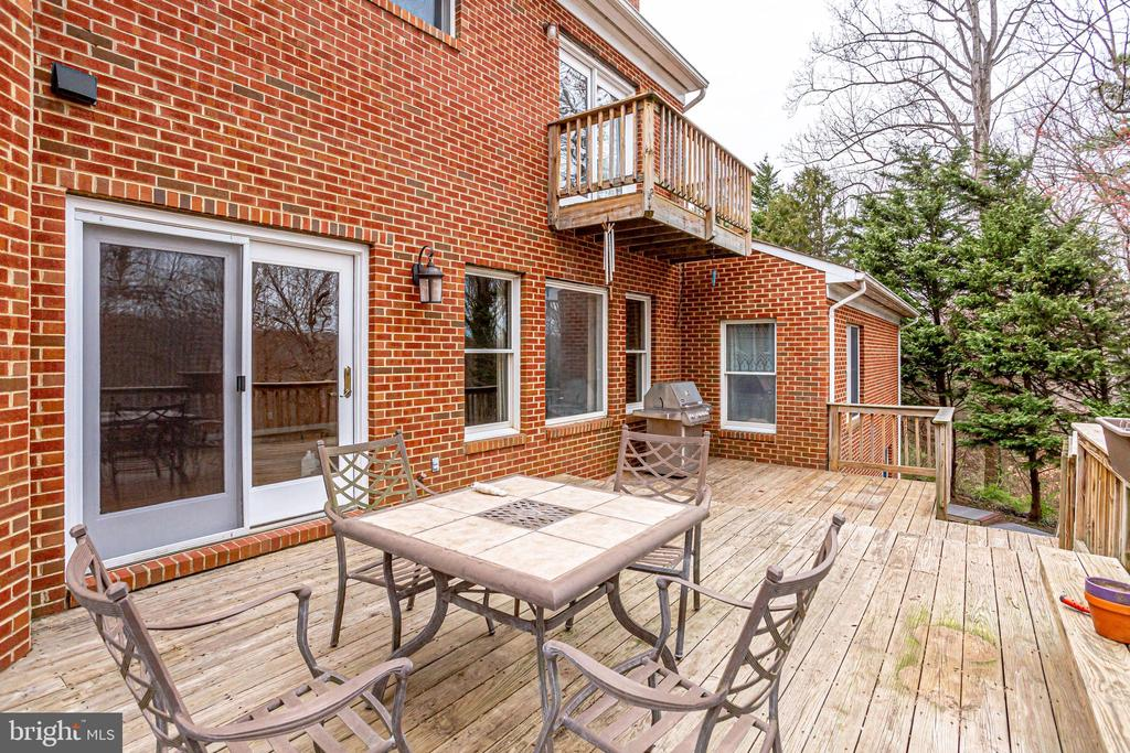 VIEW OF DECK , DOUBLE DOORS TO FAMILY ROOM - 7365 BEECHWOOD DR, SPRINGFIELD
