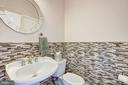 Main Level Powder Room  by mud room - 11408 WOLFS LNDG, FAIRFAX STATION