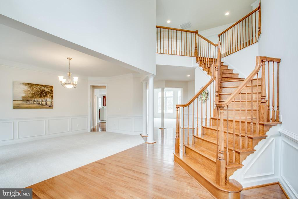 View of the dining room , stairs & upper railings - 7911 MADISON PLANTATION WAY, FREDERICKSBURG