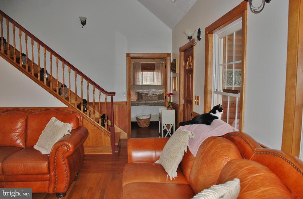 Living room showing stairway and doors to master - 1318 LOCUST GROVE CHURCH RD, ORANGE