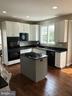 Kitchen w/ Windows overlooking deck & yard - 43773 FARMSTEAD DR, LEESBURG