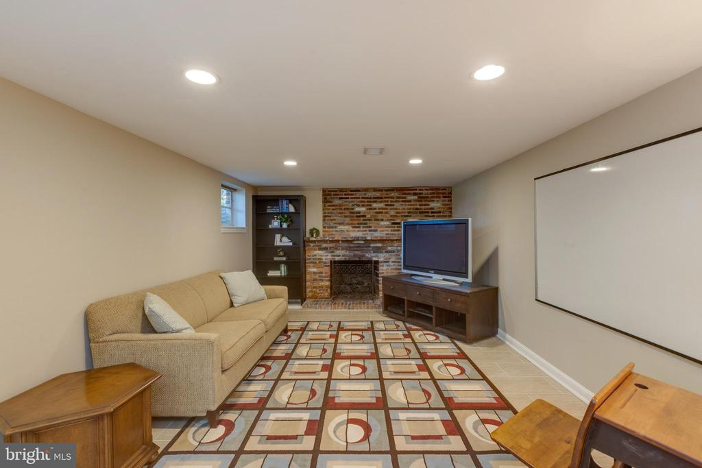 Lower level game room w/ wood burning fireplace - 4635 35TH ST N, ARLINGTON