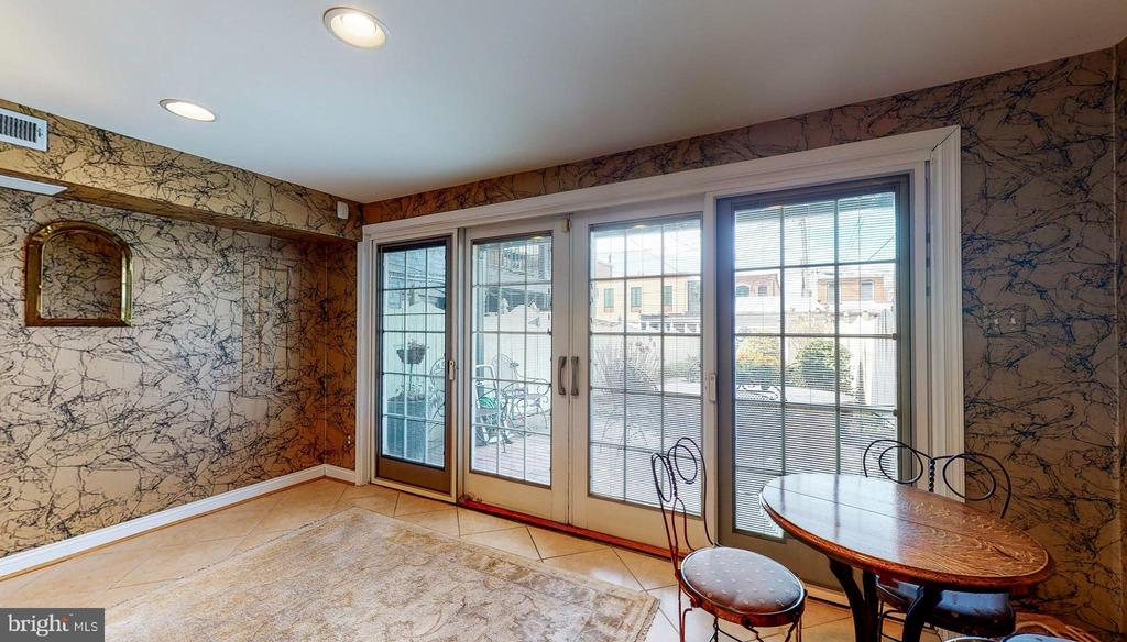 Lower level sunroom to gardens.garage - 124 S PATTERSON PARK AVE, BALTIMORE