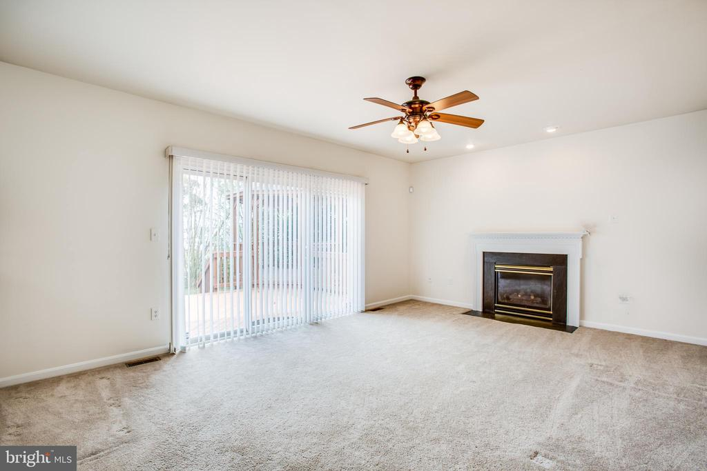 Family room with gas fireplace - 11617 DUCHESS DR, FREDERICKSBURG