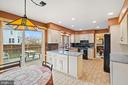 Renovated Kitchen with Braeakfast Area - 201 STONELEDGE PL NE, LEESBURG