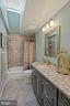 Renovated Full Bathroom with Skylight- Upper Level - 201 STONELEDGE PL NE, LEESBURG
