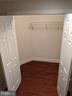Spacious Walk-In Closet #1 near Basement Landing - 18213 CYPRESS POINT TER, LEESBURG