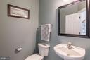 Main level powder room with pedestal sink - 20226 BROAD RUN DR, STERLING