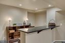 Granite bar & recessed lighting in huge rec room. - 43988 RIVERPOINT DR, LEESBURG