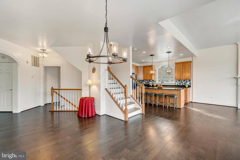 Rich walnut flooring & custom lighting on main. - 43988 RIVERPOINT DR, LEESBURG