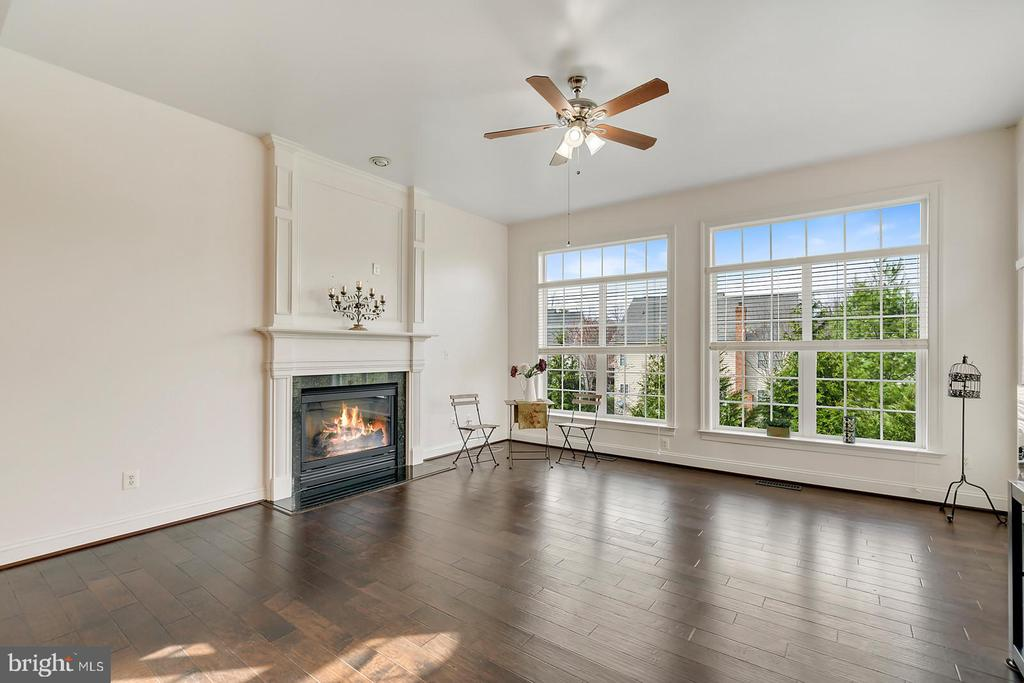 Gas fireplace warms family space off open kitchen. - 43988 RIVERPOINT DR, LEESBURG