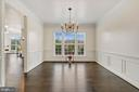 Elegant dining w/ crown & chair molding from foyer - 43988 RIVERPOINT DR, LEESBURG