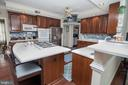 Kitchen with Corian Counters and Island - 25282 KENNEBEC DR, CHANTILLY