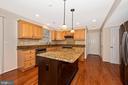 Kitchen features granite countertops - 2505 UNDERWOOD LN, ADAMSTOWN