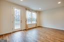 French door leads to deck and tree line - 8900 ENGLEWOOD FARMS DR, MANASSAS