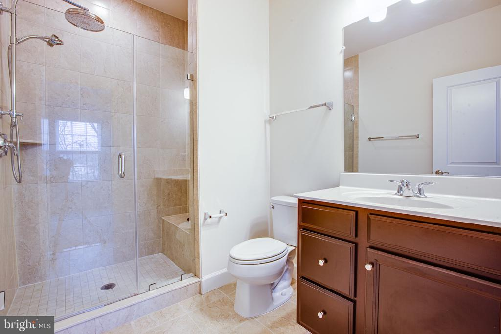 Master BathroomUpgraded tile and rain head shower - 8900 ENGLEWOOD FARMS DR, MANASSAS