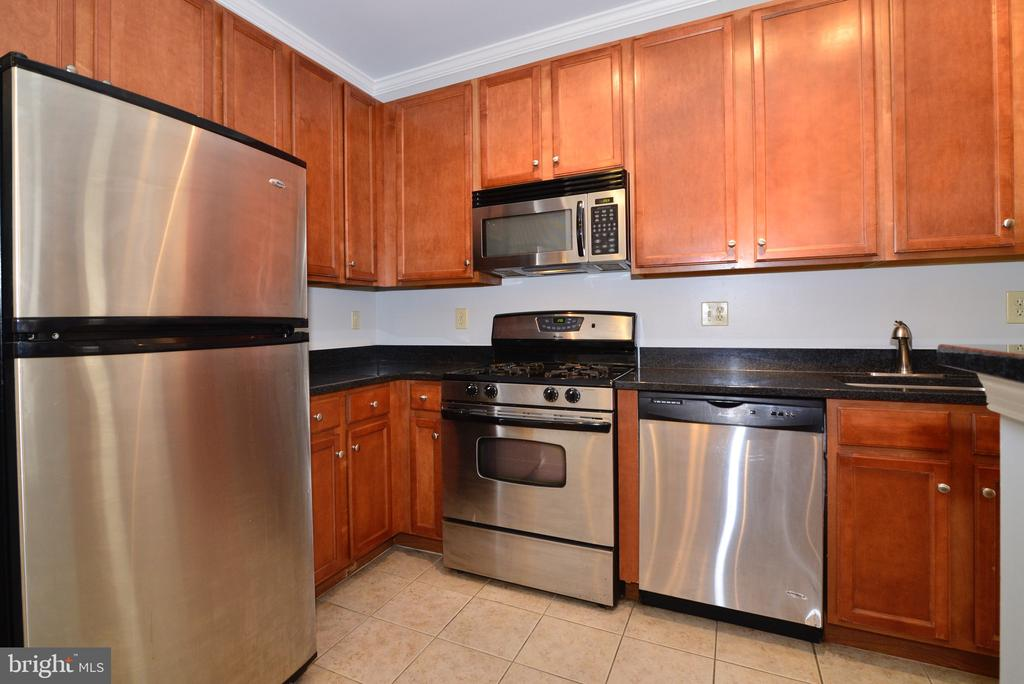 Stainless Steel appliances and tile floor - 2655 PROSPERITY AVE #119, FAIRFAX