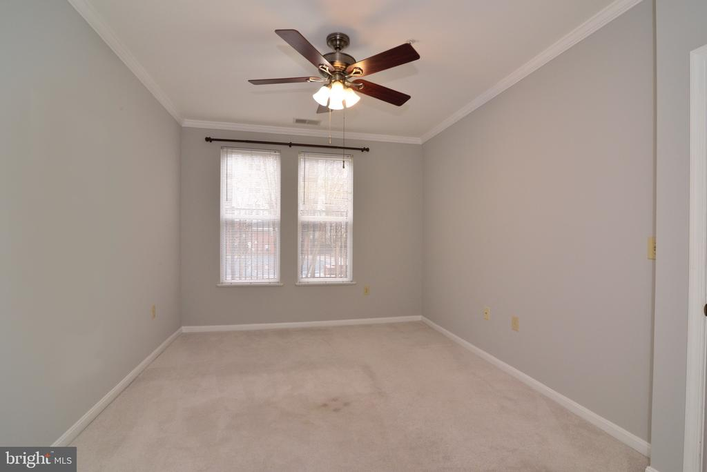 Primary  bedroom with view of pool - 2655 PROSPERITY AVE #119, FAIRFAX