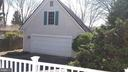 Two car garage has finished, upstairs room. - 239 W MARKET ST, LEESBURG