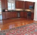 Rear addition has open floor plan. - 239 W MARKET ST, LEESBURG