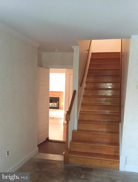 Stair from den leads to the second level - 239 W MARKET ST, LEESBURG