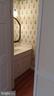 Powder room on main level. - 239 W MARKET ST, LEESBURG