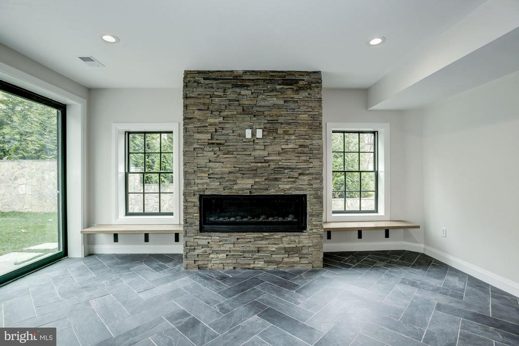 Stone gas fireplace surround. Accent benches - 1916 RHODE ISLAND AVE, MCLEAN