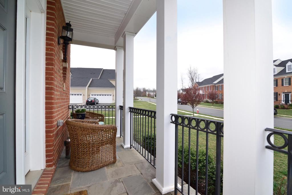 Front View with Sitting Porch - 22988 CHERTSEY ST, ASHBURN