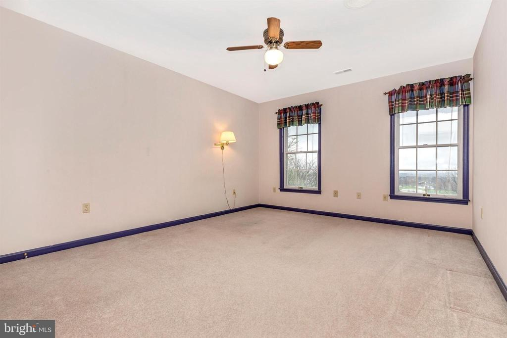 Bedroom 4 has ceiling fan and 2 closets. - 7799 COBLENTZ RD, MIDDLETOWN