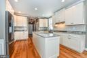Gourmet Kitchen w/ granite tops + tiled backsplash - 4802 COWMANS CT NORTH, MOUNT AIRY