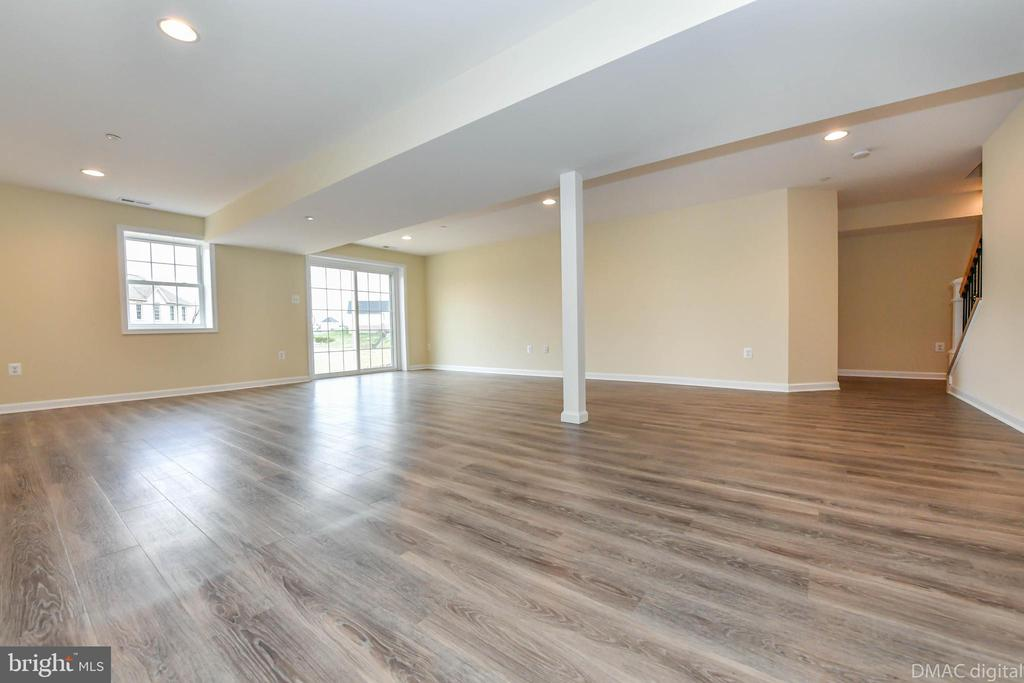 Basement rec room with vinyl plank flooring - 4802 COWMANS CT NORTH, MOUNT AIRY