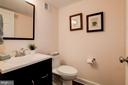 Lower level half bath - 6804 BROXBURN DR, BETHESDA