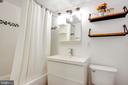 Fresh White Bathroom, Glass Tile in Shower - 1948 KENNEDY DR #101, MCLEAN