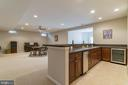 Bar with wine fridge, icemaker, and sink - 25543 THORNBURG CT, CHANTILLY
