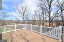 Deck overlooking wooded lot and water views - 55 STONE OAK PL, ROUND HILL