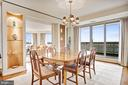 Dining room w/ built-in shelves & balcony access - 5600 WISCONSIN AVE #1408, CHEVY CHASE