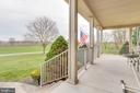 The large front porch has plenty of space - 1007 PEMBROKE WAY, CHARLES TOWN
