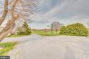 Large gravel area allows for plenty of parking - 1007 PEMBROKE WAY, CHARLES TOWN