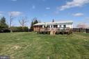 Rear of home with a wonderful flat backyard - 11833 PURCELL RD, LOVETTSVILLE