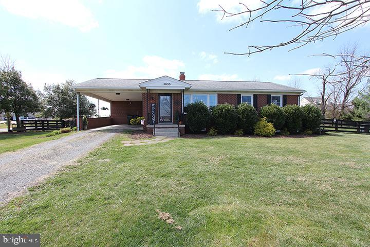 Front of 4 sided brick home with carport - 11833 PURCELL RD, LOVETTSVILLE
