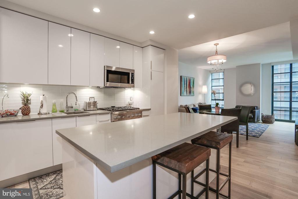 Serve, eat, drink, or work at the kitchen island - 45 SUTTON SQ SW #704, WASHINGTON