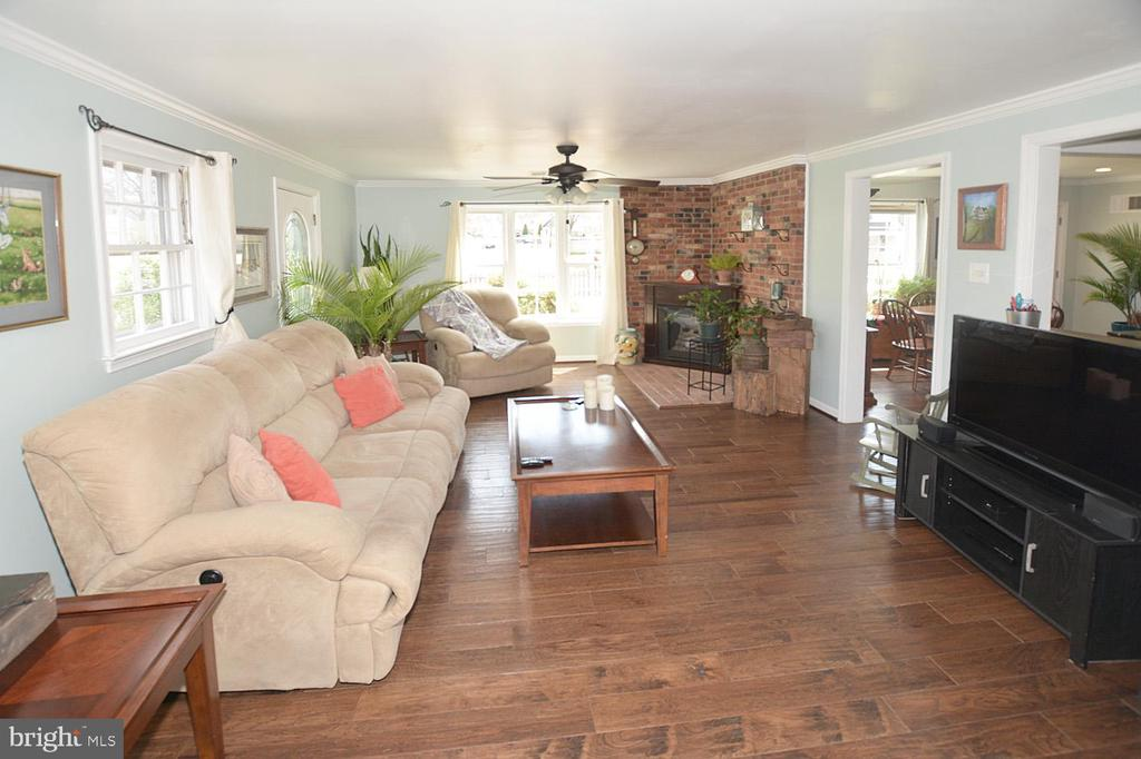 Great room with cozy fireplace. - 314 MANASSAS DR, MANASSAS PARK