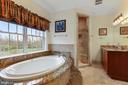 Custom tile and granite work accent this room - 2375 BALLENGER CREEK PIKE, ADAMSTOWN