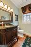 Half bath on the main level  with custom vanity - 2375 BALLENGER CREEK PIKE, ADAMSTOWN