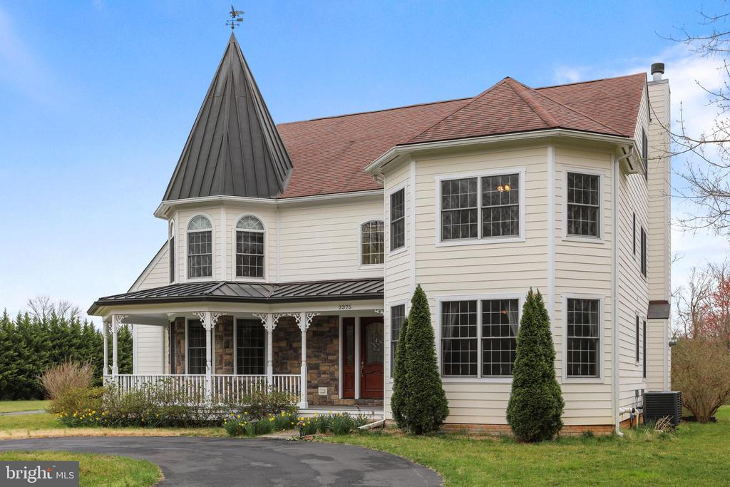 The front fascia features a victorian style turret - 2375 BALLENGER CREEK PIKE, ADAMSTOWN