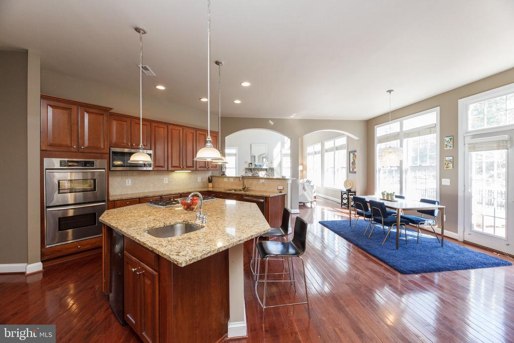 Open Kitchen with Eat-in Area leading to deck - 18754 KIPHEART DR, LEESBURG