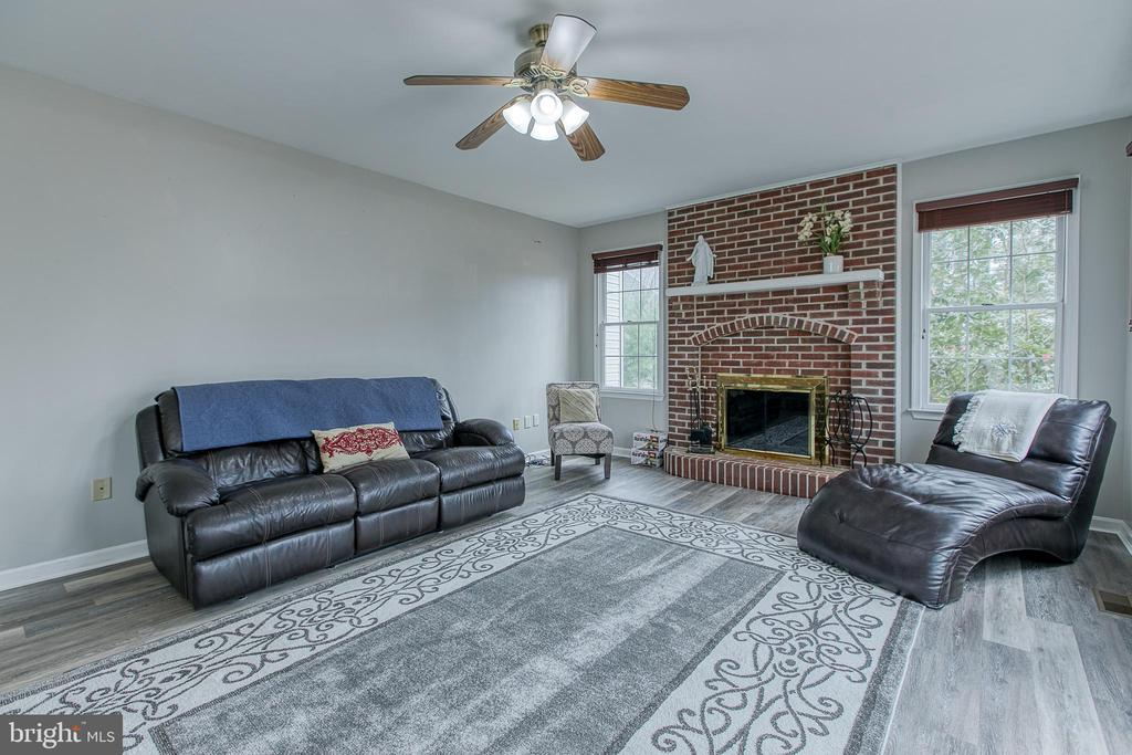 Family room with wood burning fireplace - 58 BALDWIN DR, FREDERICKSBURG
