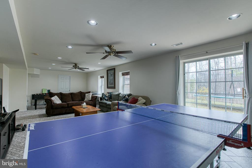 Game area/ work out area with walk out sliders - 58 BALDWIN DR, FREDERICKSBURG